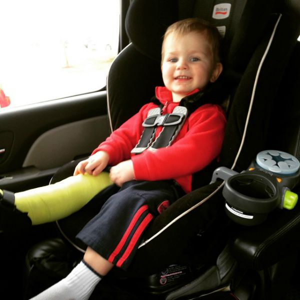 """My active toddler right after he got his cast on (and before he realized how much """"sitting still"""" would be required)."""