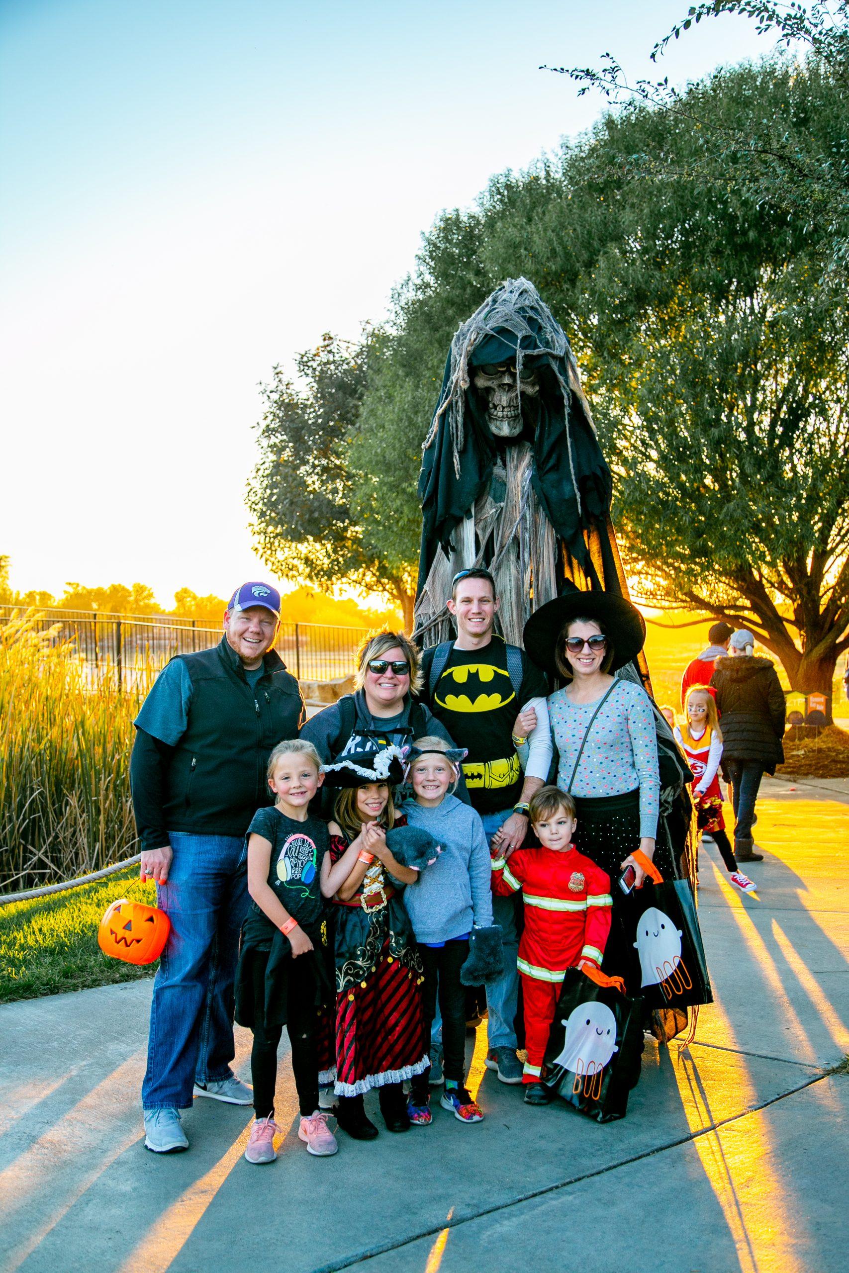 family at pumpkins at the park