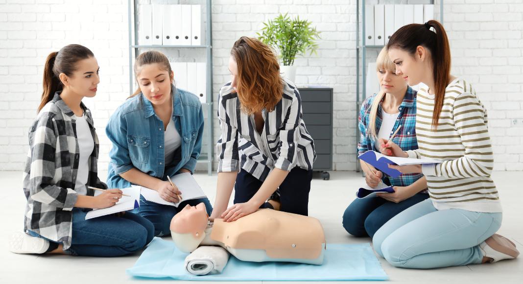 women taking a CPR class